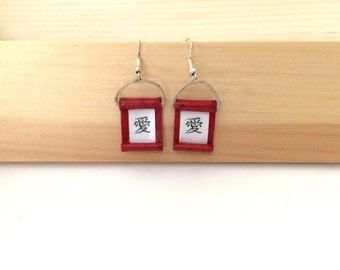 Love in Japanese calligraphy on red scroll earrings