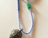 Reserved-African Trade Beads with Brass Face Pendant