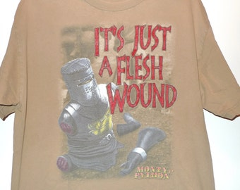 """It's Just A Flesh Wound T-Shirt Monty Python Holy Grail Black Knight Tee 42"""" Wide 28""""L Top Logo Tee Props Set Designers John Cleese Ni!"""