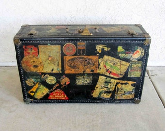 Vintage Travel Trunk with Travel Stickers. Circa 1920's - 1930's.