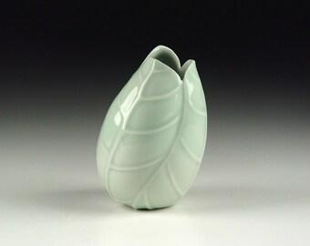 Tilted pale blue-green celadon porcelain ceramic pottery bud vase