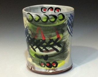 Cup with black yellow and red on white  and light yellow handmade wheelthrown pottery