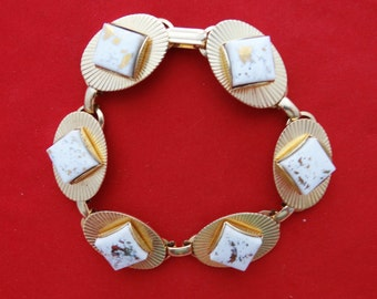 "20% off sale Vintage 1950s 7"" gold tone bracelet with white enameled stone stations in great condition, appears unworn"