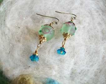 Dainty Lamp Work Bead Earrings, Mint Green with Tiny Blue Dangle