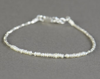 Super tiny white pearls and sterling silver beaded bracelet.Tiniest pearls ever