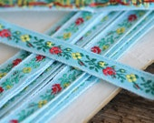 """embroidered woven flowers blue trim, 7/16"""", per meter"""