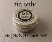 Empty ringOs Tin
