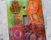 All Around the World, switch plate cover, mixed media, one of a kind, decorative wall plate, toggle switch plate, red violet, orange, green