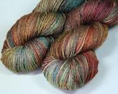 Lothlorien - Lotus BFL silk hand painted sock yarn multi brown green orange gold red
