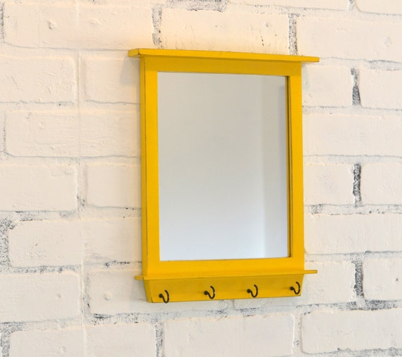 Entryway mirror with four key holder hooks by for Mirror key holder