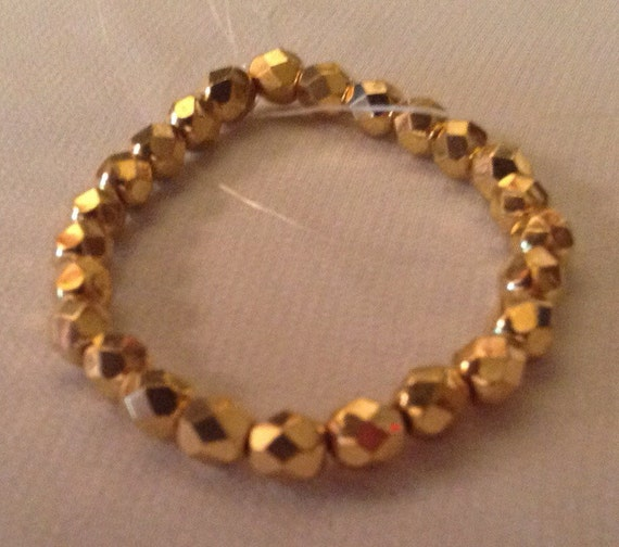 Vintage metallic  gold faceted beads 7 mm Lot of 27 beads Hard to find Bright High quality fire polished hard to find Gold tone