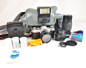CANON AE-1 SLR Camera with 3 Lenses, Bag, Filters, Flash and Strap - Complete Package