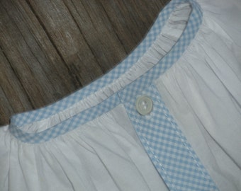 White infant daygown with gingham trim