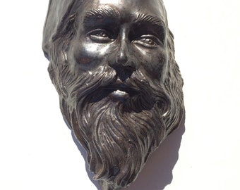 Wall hanging sculpture mask, ceramic art portrait face of a bearded man, bronze glazed