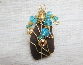 Beautiful gold tone silver plated wire wrap and crystal beads Hudson River brown sea glass. Boho chic beach seaglass beachglass  pendant.