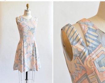 30% OFF STOREWIDE / Vintage 1990s MINI dress w/ cutaway shoulder