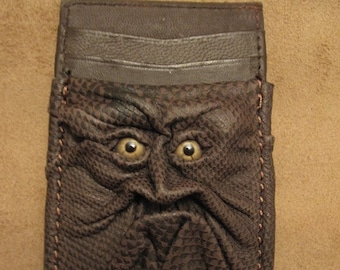 Grichels leather money and card clip - scaly olive green with green star eyes
