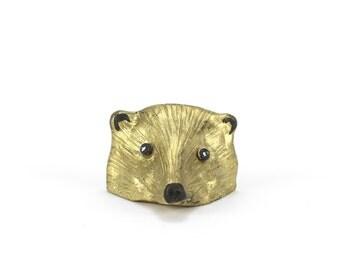 vintage cast iron gold badger head