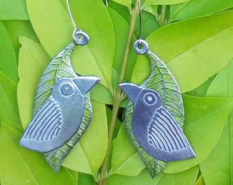 Bird earrings , aluminium bird with lime green leaves