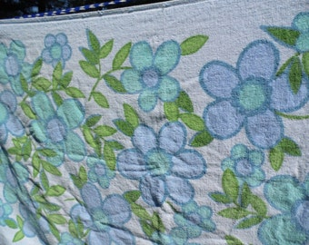 """Cannon vintage bath towel all cotton floral with flowers in blue purple and green on blue background, measures 39 1/2 by 21"""", fringed edges"""