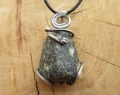 Ancient Voices - This unique piece of Preseli Bluestone is set in a Silver setting with a Spiral bail.