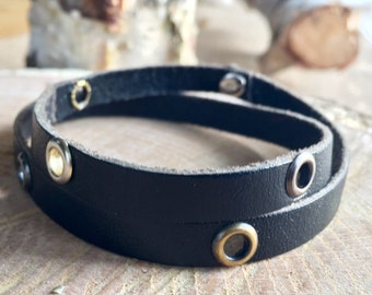 Double strand leather bracelet with mixed metal grommets