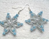 Handmade tatted earrings made of white cotton thread and white beads