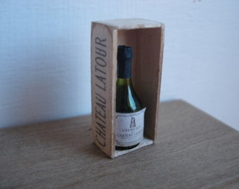 Miniature wine glass bottle in wooden box
