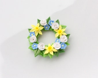 Miniature Easter wreath with yellow and blue flowers for 1:12 scale dollhouse handmade from polymer clay