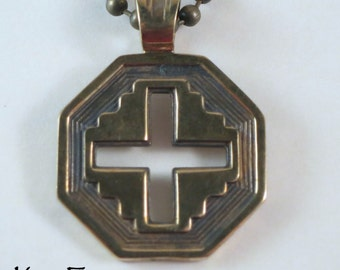 Well Balanced Cross in Golden Bronze - A blend of east and west with a little southwest thrown in for the handsome cross