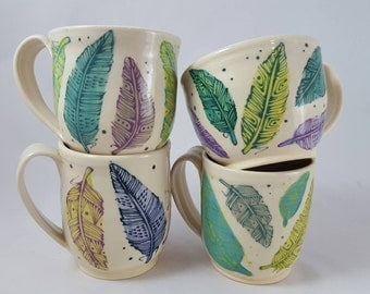 Blue and green feather mug