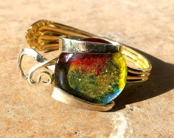 Gold plated stainless steel fork bracelet holding rainbow glitter cabachon glass stone