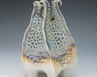 Porcelain urchin vase with curlicues in blue, purple, tan & white