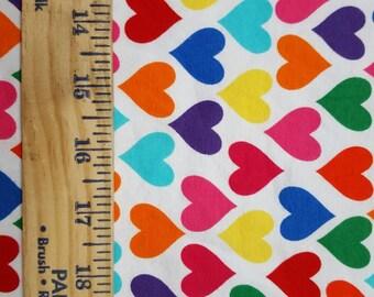 Funky Rainbow Hearts on White Cotton Lycra .