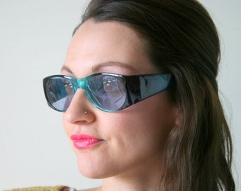 1990s BLUE Sunglasses...retro. colorful. mid century. urban. hipster. indie. chic. pink. space girl. deadstock. aviator. unisex. rocker.