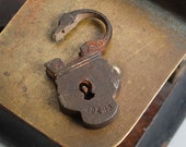 Antique small brass padlock, original dark patina.