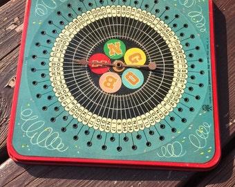Vintage bingo game spinner/pressman toy corp