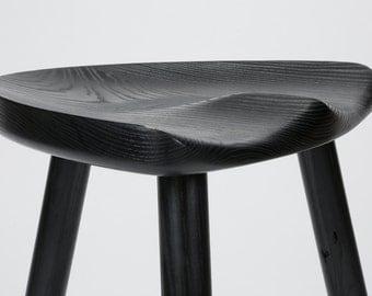 Milking stool in ebonized ash