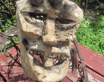 Primitive Carved Wood Mask with Tufts of Hair
