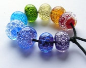 RESERVED Rainbow bubble orphans - handmade lampwork bead set of 9 glass bubble renegade beads