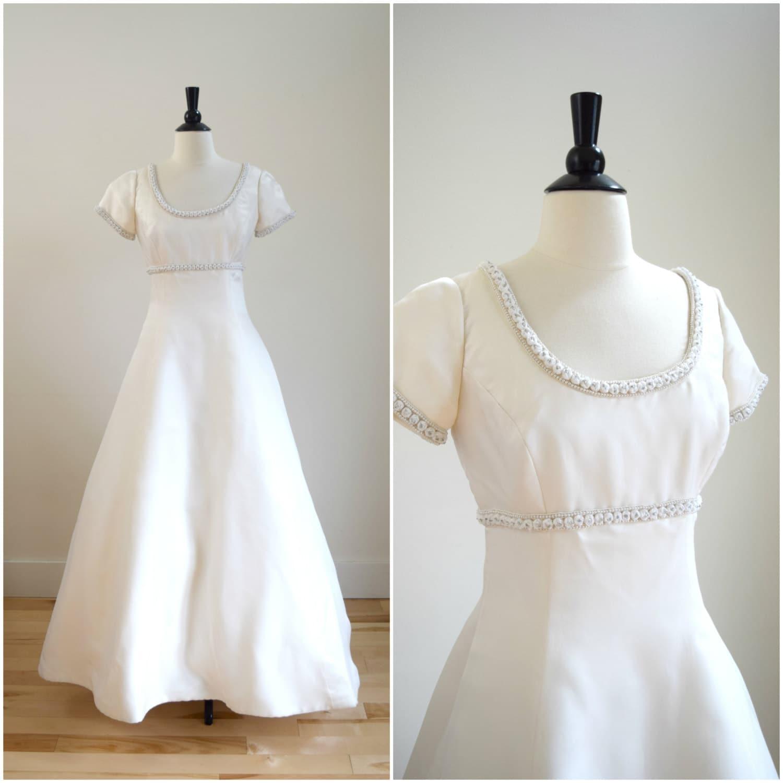 Vintage Carmela Sutera ivory silk wedding gown by
