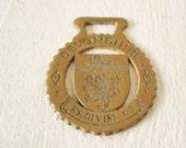 Vintage horse brass religious English British Devonshire Griffin crest