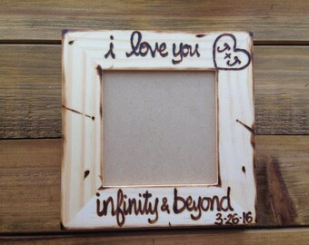 Infinity & beyond picture frame wedding • engagement • boyfriend and girlfriend • i love you • carved initials • relationship • sonogram