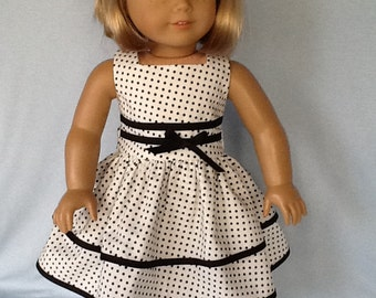 18 inch doll dress and hair clip.  Fits American Girl Dolls.  Black and white dotted dress.
