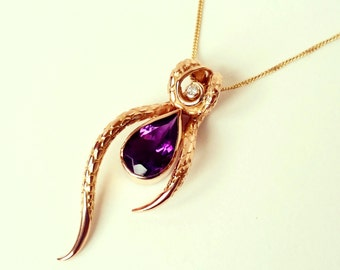 18 carat Rose gold pendant. Amethyst and diamond. snake design texture, stunning. Rose gold serpent