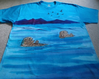 A new variation on the sea otters, they are checking out the birds flying in the sky, man's XL shirt, silk screened & dyed with procion dyes