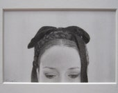 the puritan, graphite pencil drawing on paper, framed, woman's downcast eyes, delicate and detailed drawing of a woman with braids and a bow