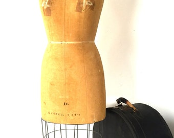 Vintage wire bottom dress form