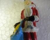 good shape vintage antique LEAD figure SANTA CLAUS with a bag of toys