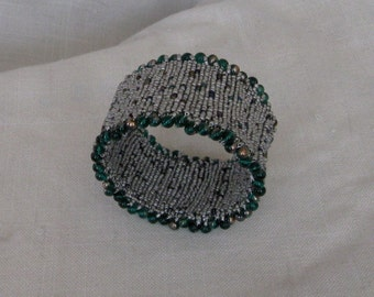 Gray seed bead bangle with iridescent seed bead highlights and green picot edge
